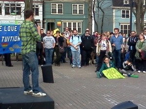 Keith MacMillan addresses rally-goers on International Day Against Homophobia and Transphobia in Halifax
