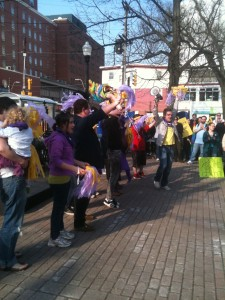 Youth Project Queerios lead rally-goers in cheers at International Day Against Homophobia and Transphobia